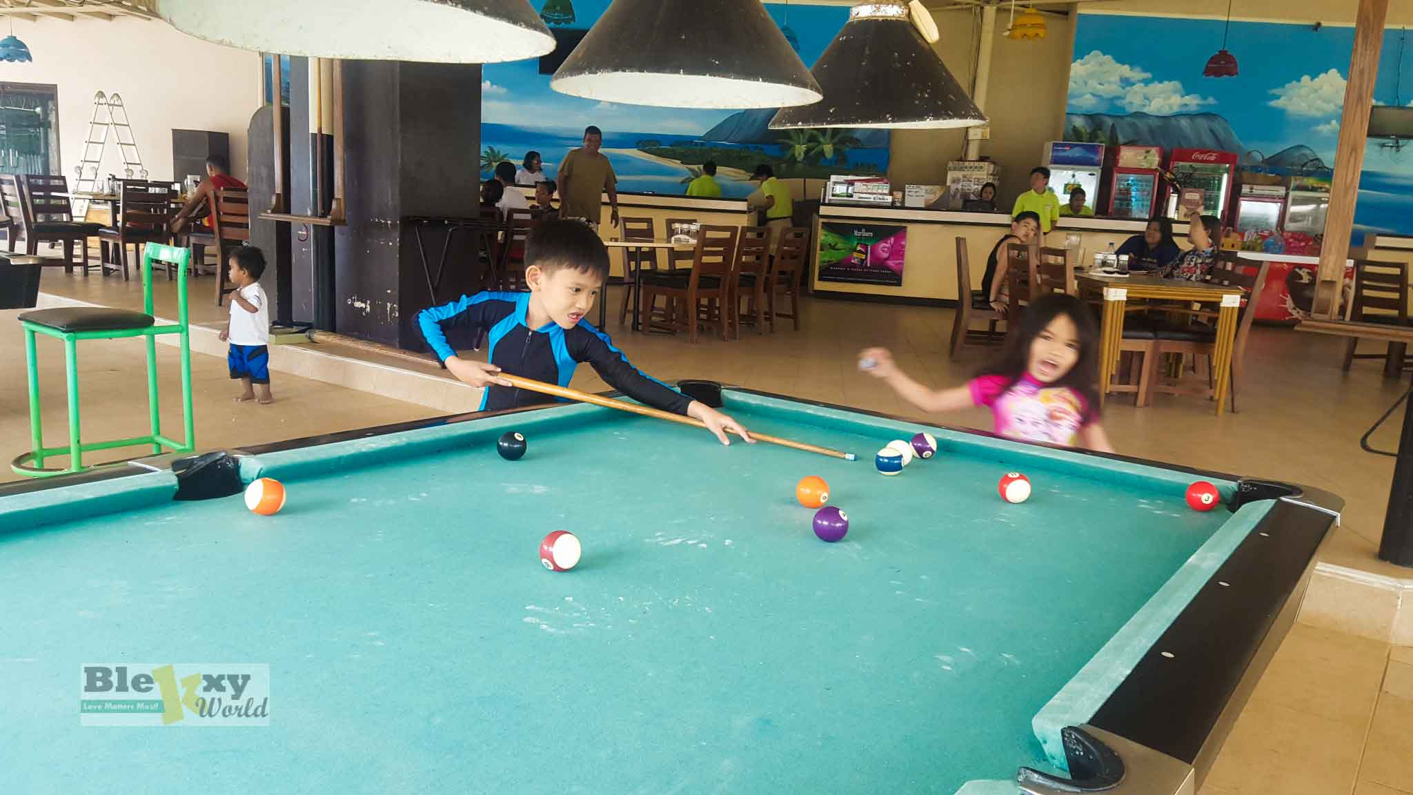 Camp-Holiday-Resort-Samal-Island-billard-hall-player
